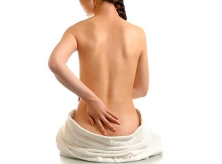 Почему болит копчик при беременности на ранних или поздних сроках, причины боли у беременных